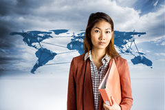 Composite image of businesswoman holding a binder Stock Image