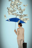Composite image of businesswoman holding blue umbrella and a briefcase Stock Image