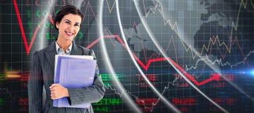Composite image of businesswoman holding folders Stock Photo