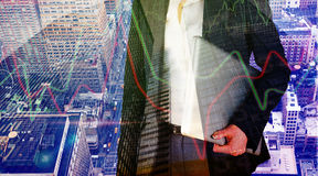 Composite image of businesswoman holding laptop. Businesswoman holding laptop against low angle view of skyscrapers stock photos