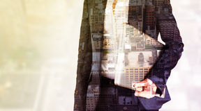 Composite image of businesswoman holding laptop. Businesswoman holding laptop against new york stock images