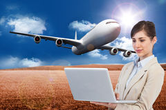 Composite image of businesswoman holding laptop Stock Photography