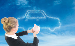 Composite image of businesswoman holding piggy bank Royalty Free Stock Photos