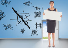 Composite image of businesswoman holding a placard Stock Photos