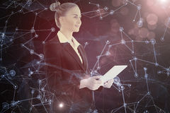 Composite image of businesswoman holding tablet Royalty Free Stock Images
