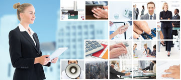 Composite image of businesswoman holding tablet Royalty Free Stock Photos