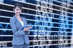 Composite image of businesswoman holding tablet Royalty Free Stock Photography