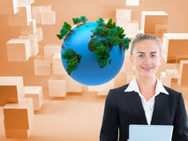 Composite image of businesswoman holding tablet Stock Photography