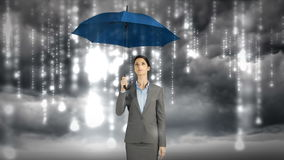 Composite image of businesswoman holding an umbrella