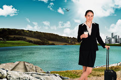 Composite image of businesswoman leaning on her suitcase holding coffee Royalty Free Stock Images
