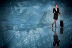 Composite image of businesswoman leaning on her suitcase holding tablet pc Stock Image