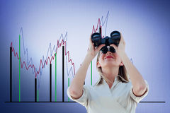 Composite image of businesswoman looking through binoculars Royalty Free Stock Images