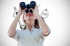 Composite image of businesswoman looking through binoculars Royalty Free Stock Image