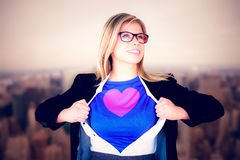 Composite image of businesswoman opening her shirt superhero style. Businesswoman opening her shirt superhero style against new york Royalty Free Stock Photography