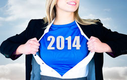Composite image of businesswoman opening her shirt superhero style Royalty Free Stock Photography