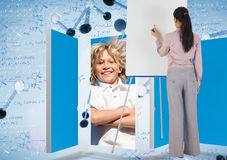 Composite image of businesswoman painting on an easel Stock Images