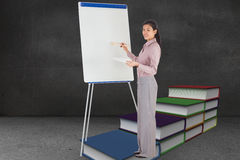 Composite image of businesswoman painting on an easel Royalty Free Stock Photography