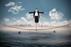 Composite image of businesswoman performing a balancing act Royalty Free Stock Photography