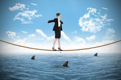 Composite image of businesswoman performing a balancing act Royalty Free Stock Photos