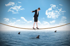 Composite image of businesswoman performing a balancing act Stock Image