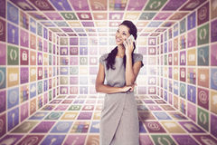 Composite image of businesswoman on the phone Royalty Free Stock Photos