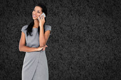 Composite image of businesswoman on the phone Stock Photos
