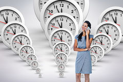 Composite image of businesswoman on the phone Stock Photo