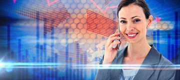 Composite image of businesswoman on the phone. Businesswoman on the phone against stocks and shares Royalty Free Stock Photo