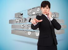 Composite image of businesswoman pointing Stock Image