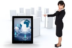 Composite image of businesswoman pointing Royalty Free Stock Photos