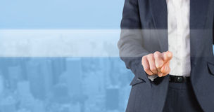 Composite image of businesswoman pointing stock photo