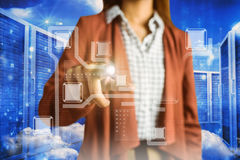 Composite image of businesswoman pointing. Businesswoman pointing against server room in blue royalty free stock images