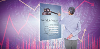 Composite image of businesswoman pointing. Businesswoman pointing against stocks and shares royalty free stock images