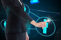 Composite image of businesswoman pointing on glowing futuristic blue background Stock Photos