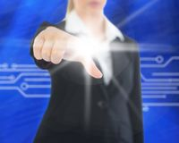 Composite image of businesswoman pointing on screen Stock Photography