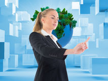 Composite image of businesswoman pointing somewhere Stock Photos