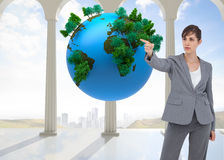 Composite image of businesswoman pointing to something Royalty Free Stock Photos