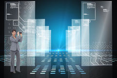 Composite image of businesswoman posing with binoculars Stock Photo