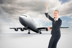 Composite image of businesswoman pulling a chain Stock Photography
