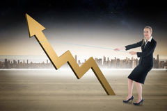 Composite image of businesswoman pulling a rope around arrow Stock Photo