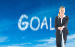 Composite image of businesswoman pulling a rope Stock Photos