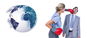 Composite image of businesswoman punching colleague with boxing gloves Royalty Free Stock Photography