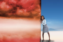 Composite image of businesswoman pushing away scene Stock Photos