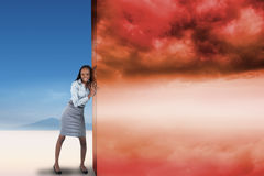 Composite image of businesswoman pushing away scene Royalty Free Stock Photo