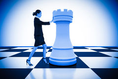 Composite image of businesswoman pushing chess piece Royalty Free Stock Photos