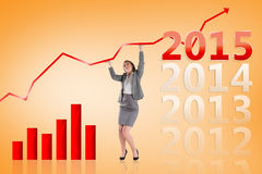 Composite image of businesswoman pushing up with hands Royalty Free Stock Photo