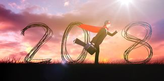 Composite image of businesswoman running while pretending to be super hero. Businesswoman running while pretending to be super hero against cloudy sky stock photos