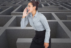 Composite image of businesswoman shouting Stock Image