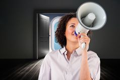 Composite image of businesswoman shouting through megaphone Stock Images
