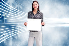 Composite image of businesswoman showing card Stock Image
